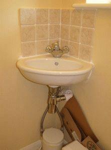 Раковина угловая для туалета
